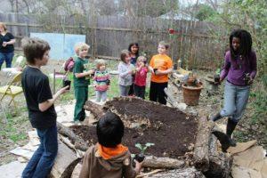 Children's Garden building a keyhole garden bed in Lorena, TX.